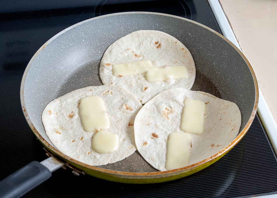 Warming up tortilas in a dry skillet