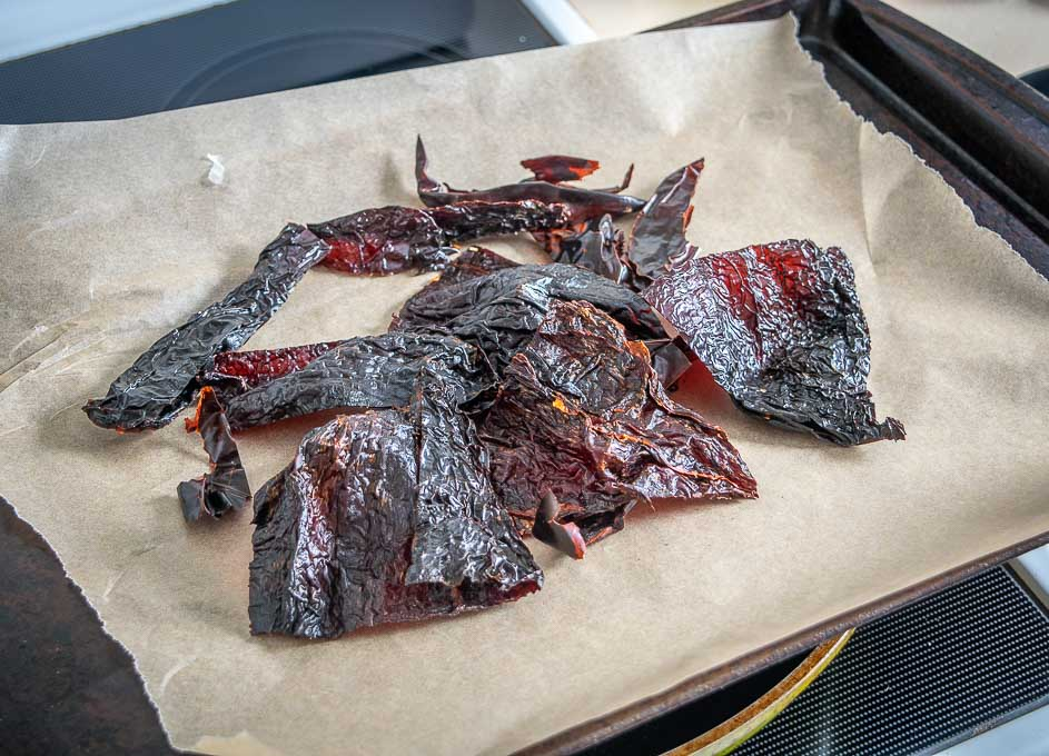 Roasting dried chile pieces in the oven
