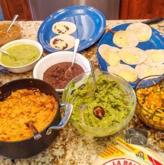 Full taco bar full of Salsas and Guacamole