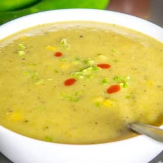 Hatch Chile Soup with cilantro stems and hot sauce